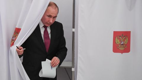 Presidential candidate, President Vladimir Putin walks out of a voting booth at a polling station during Russia's presidential election in Moscow on March 18, 2018. / AFP PHOTO / POOL / Yuri KADOBNOV        (Photo credit should read YURI KADOBNOV/AFP/Getty Images)