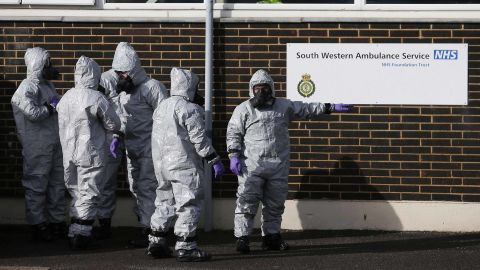 Personnel in protective coveralls and breathing equiptment cover an ambulance with a tarpaulin at the Salisbury District Hospital in Salisbury, southern England, on March 10, 2018, in connection with the major incident sparked after a man and a woman were apparently poisoned in a nerve agent attack.British soldiers were deployed on March 9 to help a counter-terrorism investigation into a nerve agent attack on former Russian spy Sergei Skripal, as speculation mounted over how London could retaliate if the Russian state is found to be responsible. Skripal and his daughter Yulia remain unconscious in a critical but stable condition following the March 4 attack in the sleepy south-western English city of Salisbury. The Counter Terrorism Policing Network requested assistance from the military to remove a number of vehicles and objects from Salisbury.   / AFP PHOTO / Daniel LEAL-OLIVAS        (Photo credit should read DANIEL LEAL-OLIVAS/AFP/Getty Images)