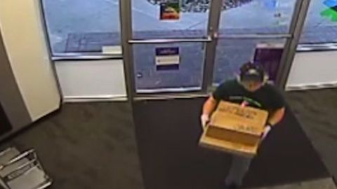 The person police believe to be Conditt takes two packages to the FedEx store.