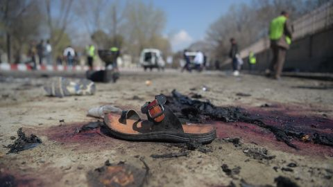 A sandal is seen laying on the ground along a road at the site of a suicide bombing attack in Kabul on March 21.