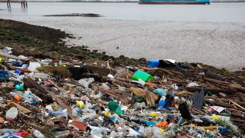 Plastics and other detritus line the shore of the Thames Estuary on January 2 in Cliffe, England.