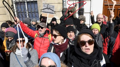 People hold up coat hangers as they demonstrate in front of the seat of the Warsaw archdiocese on March 18, 2018 in a protest against what they call the Catholic Churchs intrusion into politics by supporting a new measure to tighten the already restrictive law on abortion. / AFP PHOTO / JANEK SKARZYNSKI        (Photo credit should read JANEK SKARZYNSKI/AFP/Getty Images)