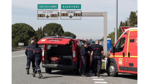 French police and firefighters secure parts of Trèbes on Friday.