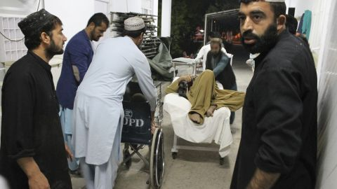 A wounded man is taken to a hospital after the Helmand car bombing.