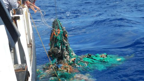 The crew pulling a ghost net from the Pacific Ocean.
