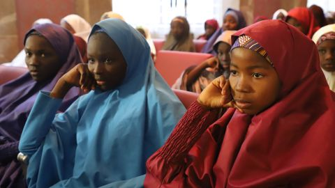 Released Nigerian school girls who were kidnapped by Boko Haram from their school in Dapchi, in the northeastern state of Yobe, sit at the Presidential Villa in Abuja before meeting with the president on March 23, 2018. The Nigerian president promised on March 23, 2018 to free the remaining Christian schoolgirl still held by the Islamist militants Boko Haram, as he prepared to meet the other released Dapchi students. A total of 104 of the 110 students seized from the school in Dapchi on February 19 were released on March 21, 2018. / AFP PHOTO / PHILIP OJISUA        (Photo credit should read PHILIP OJISUA/AFP/Getty Images)