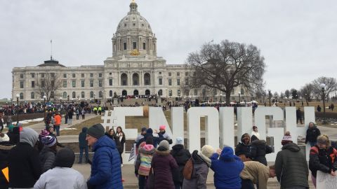 """Jennifer Skiba took this photo of marchers and a large """"#ENOUGH"""" sign Saturday in front of the capitol in St. Paul, Minnesota, on Saturday, March 24, 2018."""