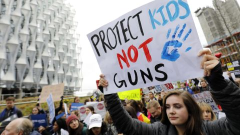 Protestors carry placards and shout slogans during a demonstration calling for greater gun control, outside the US Embassy in south London on March 24, 2018.  The London rally, in solidarity with the US movement 'March For Our Lives', is one of hundreds of gun control protests taking place globally.  / AFP PHOTO / Tolga AKMEN        (Photo credit should read TOLGA AKMEN/AFP/Getty Images)