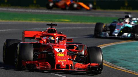 Sebastian Vettel took full advantage of a bizarre incident involving both cars of the American-owned Haas team to claim the opening race of the 2018 Formula One season in Australia.