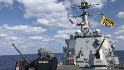 Firing drills on board the USS Dewey, a guided-missile destroyer which is designed to protect other ships and coordinate with the rest of the strike group in case of a potential missile threat.