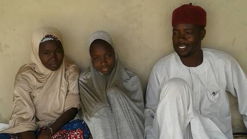 One of the freed Dapchigirls Aisha Kachalla,  with her father, Kachalla Bukar and mother, Serohvana.