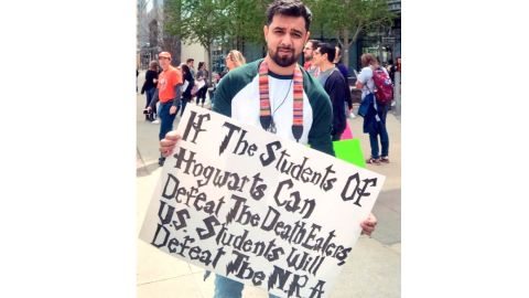 """Jorge Meza marched in Atlanta on March 24.  """"I figured what better way to have an eye catching sign then to reference the greatest series -- definitely got many people wanting to take pictures with it,"""" he told CNN."""
