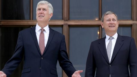 Supreme Court Justice Neil Gorsuch (L) talks with Chief Justice John Roberts (R) on the steps of the Supreme Court following his official investiture at the Supreme Court June 15, 2017 in Washington, DC.  (Photo by Win McNamee/Getty Images)