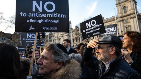 """LONDON, ENGLAND - MARCH 26: Protesters hold placards as they demonstrate in Parliament Square against anti-Semitism on March 26, 2018 in London, England. The Board of Deputies of British Jews and the Jewish Leadership Council have drawn up a letter accusing Labour Leader Jeremy Corbyn of failing to address anti-Semitism in his party. Mr Corbyn has today apologised to Jewish groups for """"pockets of anti-Semitism"""" in Labour. (Photo by Jack Taylor/Getty Images)"""