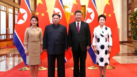 In this photo released Wednesday, March 28, 2018 by China's Xinhua News Agency, Chinese President Xi Jinping, second from right, and his wife Peng Liyuan, right, and North Korean leader Kim Jong Un, second from left, and his wife Ri Sol Ju, left, pose for a photo at the Great Hall of the People in Beijing. The Chinese government confirmed Wednesday that North Korea's reclusive leader Kim went to Beijing and met with Chinese President Xi in his first known trip to a foreign country since he took power in 2011. (Ju Peng/Xinhua via AP)
