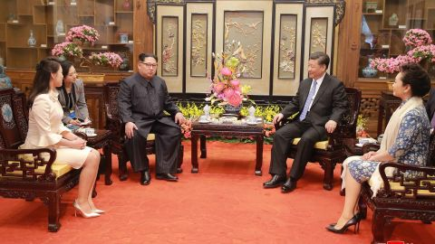 """In this March 27, 2018, photo, North Korean leader Kim Jong Un, center left, and his wife Ri Sol Ju, left, talk with Chinese counterpart Xi Jinping, second from right, and his wife Peng Liyuan at Diaoyutai State Guesthouse in Beijing. North Korea's leader Kim and his Chinese counterpart Xi sought to portray strong ties between the long-time allies despite a recent chill as both countries on Wednesday, March 28, 2018, confirmed Kim's secret trip to Beijing this week. The content of this image is as provided and cannot be independently verified. Korean language watermark on image as provided by source reads: """"KCNA"""" which is the abbreviation for Korean Central News Agency.  (Korean Central News Agency/Korea News Service via AP)"""