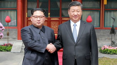 """This picture from North Korea's official Korean Central News Agency (KCNA) taken on March 27, 2018 and released on March 28, 2018 shows China's President Xi Jinping (R) shaking hands with North Korean leader Kim Jong Un in Beijing. North Korean leader Kim Jong Un was treated to a lavish welcome by Chinese President Xi Jinping during a secretive trip to Beijing as both sides seek to repair frayed ties ahead of landmark summits with Seoul and Washington.  / AFP PHOTO / KCNA VIA KNS / - / South Korea OUT / REPUBLIC OF KOREA OUT   ---EDITORS NOTE--- RESTRICTED TO EDITORIAL USE - MANDATORY CREDIT """"AFP PHOTO/KCNA VIA KNS"""" - NO MARKETING NO ADVERTISING CAMPAIGNS - DISTRIBUTED AS A SERVICE TO CLIENTS THIS PICTURE WAS MADE AVAILABLE BY A THIRD PARTY. AFP CAN NOT INDEPENDENTLY VERIFY THE AUTHENTICITY, LOCATION, DATE AND CONTENT OF THIS IMAGE. THIS PHOTO IS DISTRIBUTED EXACTLY AS RECEIVED BY AFP.  /         (Photo credit should read -/AFP/Getty Images)"""