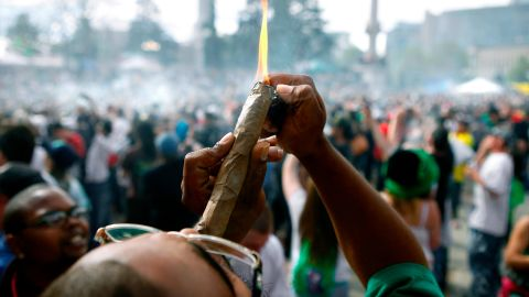 DENVER, CO - APRIL 20: A person identifying himself as Jermagisty Tha King of Denver lights up a 28 ounce blunt at exactly 4:20 p.m. as thousands gathered to celebrate the state's medicinal marijuana laws and collectively light up at 4:20 p.m. in Civic Center Park April 20, 2012 in Denver, Colorado. Colorado goes to the polls November 6 to vote on a controversial ballot initiative that would permit possession of up to an ounce of marijuana for those 21 and older. (Photo by Marc Piscotty/Getty Images)