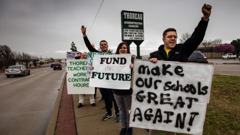 Teachers protest outside Thoreau Demonstration Academy to call for higher wages and more support for schools.
