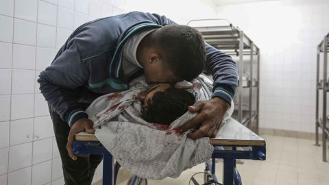 A relative mourns over Omar Wahid Samur, a Palestinian farmer killed by Israeli fire early Friday.