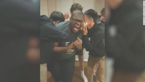Micheal Brown celebrates his acceptance to Stanford with his friends.