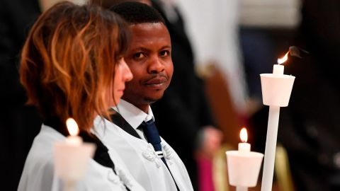 Migrant John Ogah looks on after being baptized by Pope Francis during the Easter Vigil at St. Peter's Basilica.