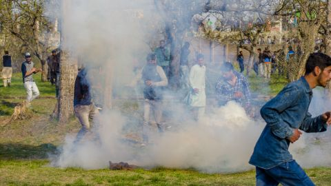 Protesters clash with Indian policemen following gun fights between militants and Indian forces in Kashmir on April 1, 2018.