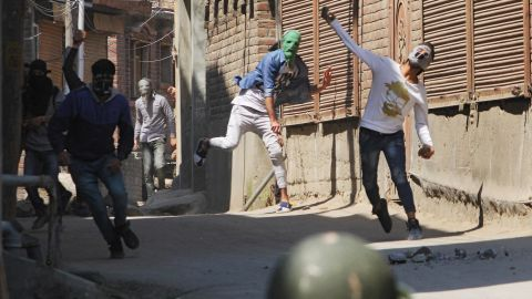 Protesters clash with Indian policemen in Kashmir on April 1, 2018.
