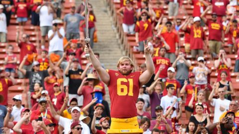 Jake Olson directs the band after playing in his first NCAA football game between the Western Michigan Broncos and the USC Trojans on September 2.