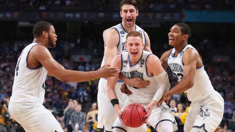 SAN ANTONIO, TX - APRIL 02:  Donte DiVincenzo #10 of the Villanova Wildcats celebrates with teammates after defeating the Michigan Wolverines during the 2018 NCAA Men's Final Four National Championship game at the Alamodome on April 2, 2018 in San Antonio, Texas. Villanova defeated Michigan 79-62.  (Photo by Tom Pennington/Getty Images)
