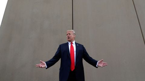 """In this March 13, 2018 photo, President Donald Trump speaks during a tour as he reviews border wall prototypes in San Diego. Trump hails the start of his long-sought southern border wall, proudly tweeting photos of the """"WALL!"""" Actually, no new work got underway. The photos show the continuation of an old project to replace two miles of existing barrier. (AP Photo/Evan Vucci)"""