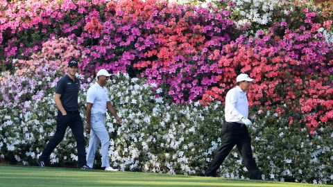 Woods was touted as one of the favorites after impressing in his early-season events. He also set tongues wagging by playing a practice round with old rival Phil Mickelson, right.