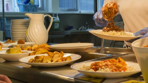 A woman serves food to children in a school canteen in Wales. Potatoes, pizza and other dishes are on the menu. Meanwhile, a spotlight has been turned on what children eat for lunch in wake of a rising obesity epidemic among the world's youth. In the United Kingdom, obesity is estimated to affect about one in every five children aged 10 to 11.