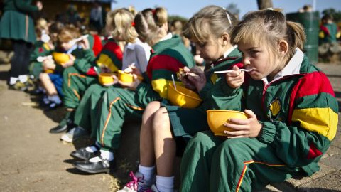 Students eat lunch at David Brink Primary School in Rustenburg, South Africa, where the number of students benefiting from the school's feeding program jumped from 65 to 185 students within a four-month period in 2014. During that time, many local mine workers and their families were under a lot of financial strain.