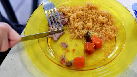 A child eats lunch, including couscous, meat and vegetables, at a municipal school in the city of Bordeaux, France. Parents of pupils in the area are more worried about the plastic plates students are eating on than the actual lunch itself. Parents have asked for a return to traditional dishes as they are concerned about the presence of certain chemicals on the plates.