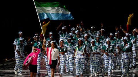 Sierra Leone's flagbearer Hafsatu Kamara leads the delegation during the opening ceremony.