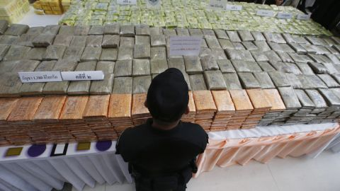 A  police officer stands guard next to seized drugs during a news conference in Bangkok on April 3.