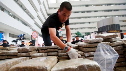 Police pack away seized marijuana after a press conference in Bangkok, Thailand on Tuesday.