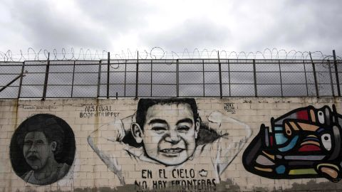 """View of murals reading """"In the sky there are no borders"""" on the US-Mexico border wall in Tijuana, Baja California, northwestern Mexico on April 2, 2018."""