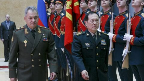 Russian Defense Minister Sergei Shoigu, left, and China's Defense Minister Wei Fenghe review an honour guard prior to their talks in Moscow, Russia, Tuesday, April 3, 2018.