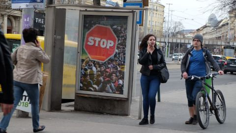An advertisement at a bus stop in Budapest calling for an end to migration.