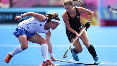 Rebecca Condie of Scotland and Shiloh Gloyn of New Zealand compete for the ball during the Pool B hockey match between New Zealand and Scotland.