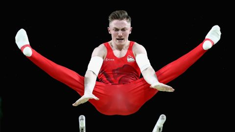 Nile Wilson of England competes on the parallel bars in the men's team final and individual qualification during the artistic gymnastics.