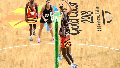 Ameliaranne Ekenasio of New Zealand shoots during the netball match between New Zealand and Uganda.