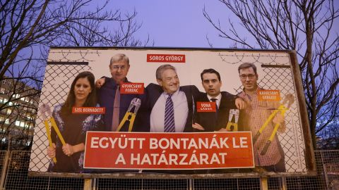 """A Fidesz billboard used during the election campaign features Soros among opposition figures and says, """"They would dismantle the border fence together."""""""