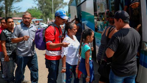 """Central American migrants traveling with the annual """"Stations of the Cross"""" caravan board a bus that will take them to Mexico City, at the sports club where they had been camping out in Matias Romero, Oaxaca State, Mexico, Thursday, April 5, 2018. Migrants in the caravan that drew criticism from U.S. President Donald Trump began packing up their meager possessions and boarding buses to the Mexican capital and the nearby city of Puebla. (AP Photo/Felix Marquez)"""