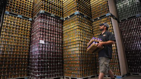 An employee carries beer at the Oskar Blues brewery and brew pub in Colorado.