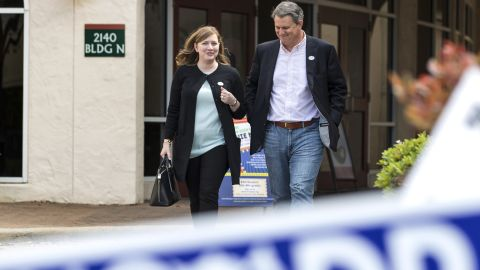In this March 6, 2018, photo, Lizzie Pannill Fletcher and her husband, Scott Fletcher, walk out of the polling place at St. Anne's Catholic Church after voting in the primary election in Houston. Democrats are salivating at the prospect of flipping a wealthy Houston enclave that has been solidly Republican since sending George H.W. Bush to Congress in 1967 -- the kind of race they need to win for any hope of retaking the House in the 2018 midterm. (Brett Coomer/Houston Chronicle via AP)
