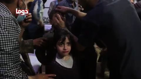 A frame from an activist's video purportedly shows children being treated for symptoms of a chemical attack.