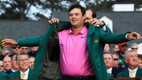 Patrick Reed  is awarded the Green Jacket by 2017 winner Sergio Garcia of Spain after winning the Masters at Augusta.